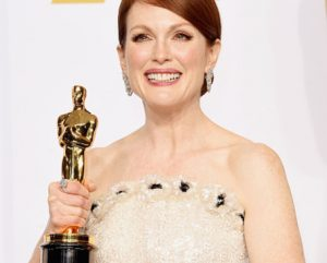 HOLLYWOOD, CA - FEBRUARY 22: Actress Julianne Moore winner of the Best Actress in a Leading Role Award for 'Still Alice' poses in the press room during the 87th Annual Academy Awards at Loews Hollywood Hotel on February 22, 2015 in Hollywood, California. (Photo by Jason Merritt/Getty Images)